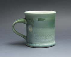 Marked down from $20. Handcrafted pottery coffee mug, ceramic teacup, stoneware. Glazed inside with a glossy, easy to clean clear glaze and outside with glossy, transparent jade green. Small surface crack on inside bottom. Sealed with glaze. Will not leak.  More Blue Parrot cups and mugs: http://www.etsy.com/shop/BlueParrotPots?section_id=6797001  Approx. 3.75x 3. (opening) Will hold approx. 12 ounces of your favorite beverage.  Food, dishwasher, and microwave safe, ...