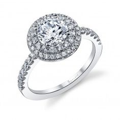 Sylvie Collection - This classic diamond engagement ring features a 1 carat round center with a total of 0.51 carats in our signature double halo and shimmering diamonds flowing down the shank.