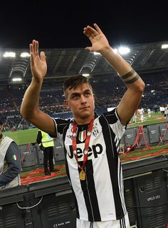 Paulo Dybala of Juventus FC celebrates the victory after the TIM Cup match between AC Milan and Juventus FC at Stadio Olimpico on May 21, 2016 in Rome, Italy.