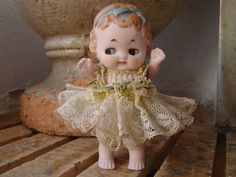 Antique,wire-jointed German bisque baby/toddler doll in original lace dress,8 cms. high via Etsy.