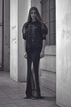 Alia B Pre-Fall 2014  Sweater-cut top in synthetic leather appliqués and sheer organza sleeves, worn with a sliced-open skirt in knit.