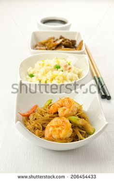 Chinese food dishesm cantonese rice, noodles, beef with bamboo by MilaCroft, via Shutterstock