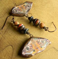 Boho chic moth beaded earrings in shades of pink, orange and bronze, very unique and full of character. These artisan moth drops were made by my friend, Petra Carpreau, whose work I adore so I matched them with Czech glass beads in bronzy pink, Picasso red and Bordeaux. The ear wires are oxizidized copper and the length is 2.6 inches, and the width is 1 3/8. They are amazingly lightweight FOR THEIR SIZE.