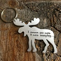 New Larger Thicker Size (smaller size still available in my listings). Simple, Thoughtful and Adorable... This is a 2.25x2 inch 14 gauge aluminum Moose Keychain! Hand stamped with I moose you more & more everyday. I moose you more & more each day can also be stamped onto it. Want it