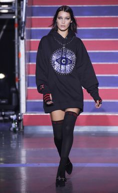 1ed9f5528fb47 Bella Hadid hit the stage in London wearing the Hooded Fleece Dress and  Gigi Hadid Suede Heeled Boot from the new TOMMYNOW Fall 2017 collection.