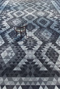 Triangle tile pattern design in black, white, and grey.