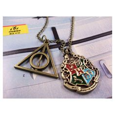 Harry Potter Hogwarts School Seal Pendant Necklace and harry potter... ($0.16) ❤ liked on Polyvore featuring jewelry, necklaces, harry potter, chain pendant necklace, pendant necklace, pendant jewelry, chains jewelry and chain pendants