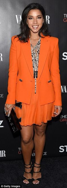 Colorful: Hannah Bronfman stood out in a bright orange ensemble, while actress Lena Hall f...