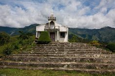 A small church is elevated on a hill in the midst of an incredible mountain landscape near Maubisse, East Timor