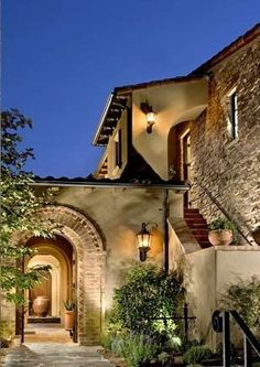 Spanish colonial entry courtyard features a cantera for Mediterranean style architecture characteristics