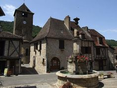 Autoire – located in Lot,  one of the 'most beautiful villages of France, where little has changed in 800 years.  Its  filled with a  attractive 16th and 17th century honey coloured houses, a pretty church and central fountain