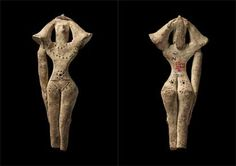 Front and back views: Marl clay female figurine symbloising fertility; Middle Kingdom Dynasty 12 - Second Intermediate Period (1985-1550 BC); From excavations at Abydos.