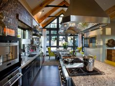 The kitchen flows straight into the dining room — a floor plan ideal for entertaining. To unify the two spaces, designer Linda Woodrum used the same yellow leather from the kitchen's bar stools on the dining room's wingback chairs.