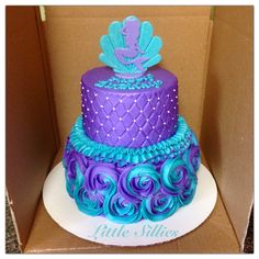 Purple and teal rosettes, quilting and ruffles. Seashell and mermaid topper.