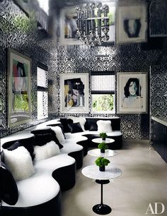 Andy Warhol portraits of Mick Jagger are arrayed on walls covered in psychedelic metallic wallpaper in Tommy Hilfiger's Miami house   archdigest.com