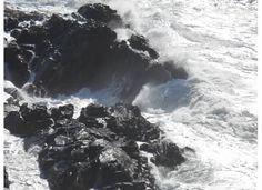 The surf crashing on the rocks in Australia