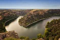 "Hoces del Rio Duratón Natural Park is a natural park of 5,037 hectares 12 km east from Sepúlveda, Segovia. Its name refers to the Duratón River. ""Las Hoces"" refers to the series of 100m high gorges that were formed by the Duratón. Saint Fructus established himself here as a hermit in the 8th century; a monastery dedicated to him also exists within the park."