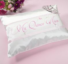 """As a traditional, Quinceanera pillow, this satin pillow is decorated beautifully with pink transfer art which reads """"Mis Quince Anos""""."""
