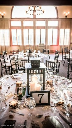 Our centerpieces (Lanterns from Ikea; DIY table numbers and cork-wrapped votives; Wedding at Valenzano Winery, Shamong, NJ; Photo by Stephanie Jones Photography)