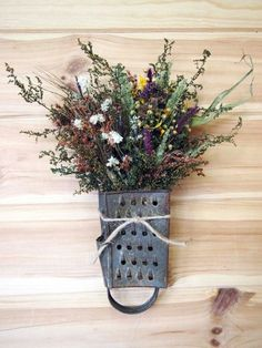 Use your imagination to turn nothing into something. | cheese grater as a dried wildflower bouquet holder