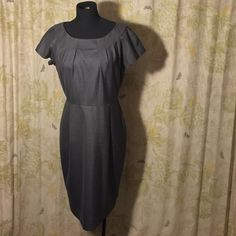 """Classic Gray Business Dress 88% polyester, 12% rayon, lining is 10% polyester. 40"""" bust, 32"""" waist, 38.5"""" long from back to bottom hem,  great basic for your wardrobe  the details set it apart and make it feminine Calvin Klein Dresses Midi"""