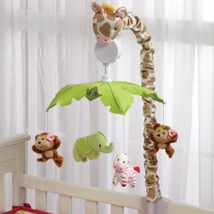 Baby nursery crib mobile This musical cot mobile will help soothe your little one to sleep, gently spins while playing Brahms Lullaby. Features Miss Giraffe and her sweet safari friends in shades of pink, tan, white, and light green. Jungle Book Nursery, Jungle Baby Room, Safari Nursery, Nursery Themes, Nursery Decor, Nursery Ideas, Storybook Nursery, Giraffe Nursery, Nautical Nursery