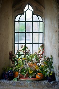 Fruit and flowers from the castle garden in front of this beautiful window