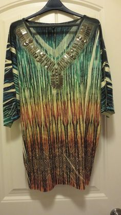 In like new condition. 3/4 sleeves tunic style. Embellished with metal. Classy.