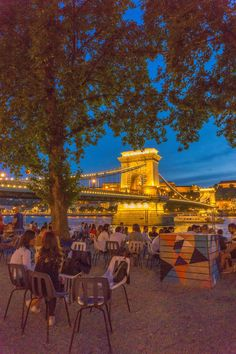 Budapest 4 day travel itinerary - people sitting on a cafe next to Chain Bridge