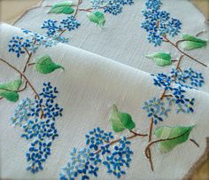 Check out this item in my Etsy shop https://www.etsy.com/uk/listing/550262478/hand-embroidered-blue-lilacs-vintage