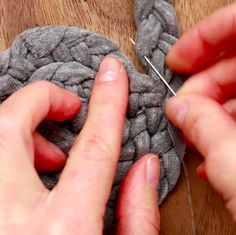 Coil the braid, making stitches in between every layer to hold them in place. | These T-Shirt Mats Are So Easy And Fun You Will Make One For Everyone