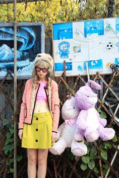 Hat by Jennifer Ouellette, sunglasses by Illesteva,  jacket by Orla Kiely, top by Milly, skirt by Maison Kitsuné.