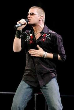 Rob Thomas. I absolutely adore the way he lays his hand across his chest and/or stomach while he's singing.