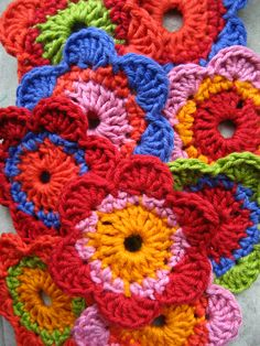I was inspired by the crocheted flower scarves made my Jen flickr.com/photos/persephonesawakening My flowers are a bit bigger and will be joined singly in a line, I think about 20 flowers in total.
