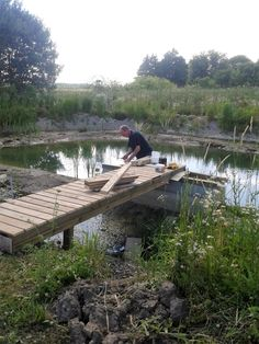 July quickly build a dock, because we are having a party in a few days. Building A Dock, Garden Bridge, Pond, Outdoor Structures, Natural, Party, Water Pond, Receptions, Nature