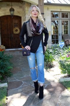 black booties with distressed boyfriend jeans by AG, paired with an edgy, black sweatshirt by C & C California and an infinity scarf