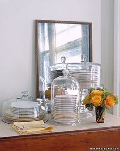fancy dish display without buying hutch. plates in cake stands. -martha stewart living