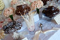 A decadent candy bar was provided for guests to take home sweet treats, including rock candy, lollipops, chocolate, and gum balls. #CandyTable Photography by: Handeland Tesoro Photography. Read More: http://www.insideweddings.com/weddings/romantic-ocean-view-wedding-in-santa-barbara-california/464/#.VXCmQp1rdDk.gmail