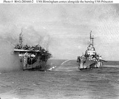 USS Birmingham comes alongside the burning USS Princeton
