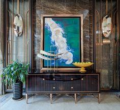 LUXURY DECOR   an elegant and sophisticated entryway decor. dark wood veneer sideboard with metal feet, matches the wall decor   www.bocadolobo.com #modernentryway #entrywayideas