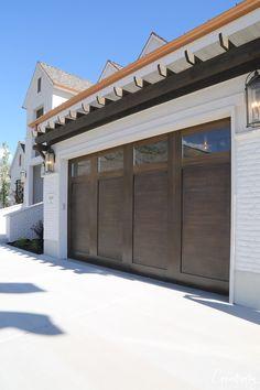 2018 Utah Valley Parade of Homes: Part 2 Dark wood garage door. Arive Homes 2018 Utah Valley Parade Garage House, Garage Entry Door, Modern Garage Doors, Garage Door Styles, Garage Door Makeover, Wood Garage Doors, Wood Entry Doors, Garage Door Design, Industrial Garage Door