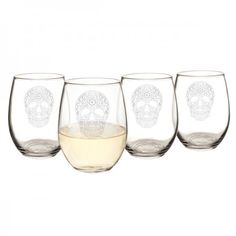 Sugar Skull 21 oz. Stemless Wine Glasses (Set of 4)  The Sugar Skull Stemless Wine Glasses are perfect for Day of the Dead, Halloween, or everyday celebrations. Engraved with an artistic sugar skull design, each glass is crafted with a modern stemless belle and a well-balanced base. Toast at your next gathering with this festively decorated skull glassware or give as a gift to the host of the celebration.