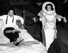 George Hamilton & Natalie Wood between scenes of 'All the Fine Young Cannibals'  -  Natalie is on a 'Leaning Board' so as not to crush her gown.  1961