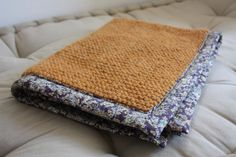 Knit on one side and backed and bound with woven cotton. Great idea!