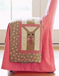 Baby rickrack adds playfulness and dimension to this cute, seasonal wall hanging.