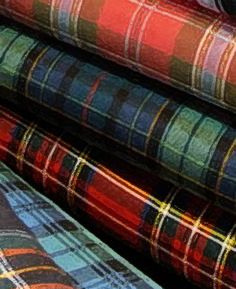 Plaid is the U.S. & Canadian English word for Tartan, a pattern consisting of crossed horizontal and vertical bands in two or more colours in woven cloth.
