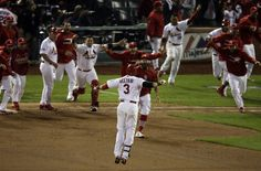 St. Louis Cardinals' Carlos Beltran celebrates with teammates after his game-winning hit during the 13th inning of Game 1 of the National League baseball championship series against the Los Angeles Dodgers Saturday, Oct. 12, 2013, in St. Louis. (AP Photo/Chris Carlson)