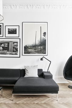 A Careful Renovation of a 19th-Century Flat in Gothenburg Brings it Back to Life - Photo 4 of 11 - In the living room, a Vipp table lamp rests on a Hockney sofa by Eero Koivisto for David Design.