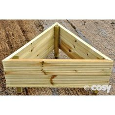 A triangular shaped raised bed for a mathematical garden or buy a few and create a tessellated flower bed.