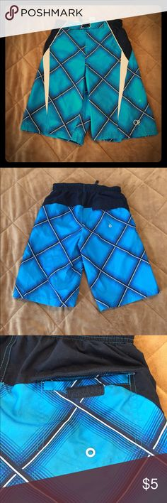Swim trunks Turquoise mesh lines trunks with back pocket. Lower left leg has a spot on it. Might be chlorine exposure  but pretty sure it is permanent. Finally unpacking stored boxes and wardrobes from last move. If I haven't missed it by now it needs to go! OP Swim Swim Trunks